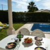 Sunny, South Facing Saltwater pool with lots of lawn areas & sea views.