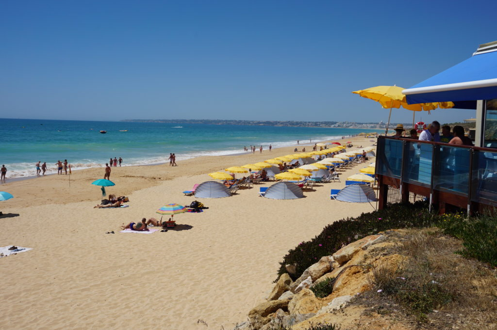West of Albufeira Marina. The main. long stretch Blue Flag Beach of Gale.