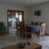 The spacious open plan lounge/diner overlooks, kitchen, garden, pool & sea views.