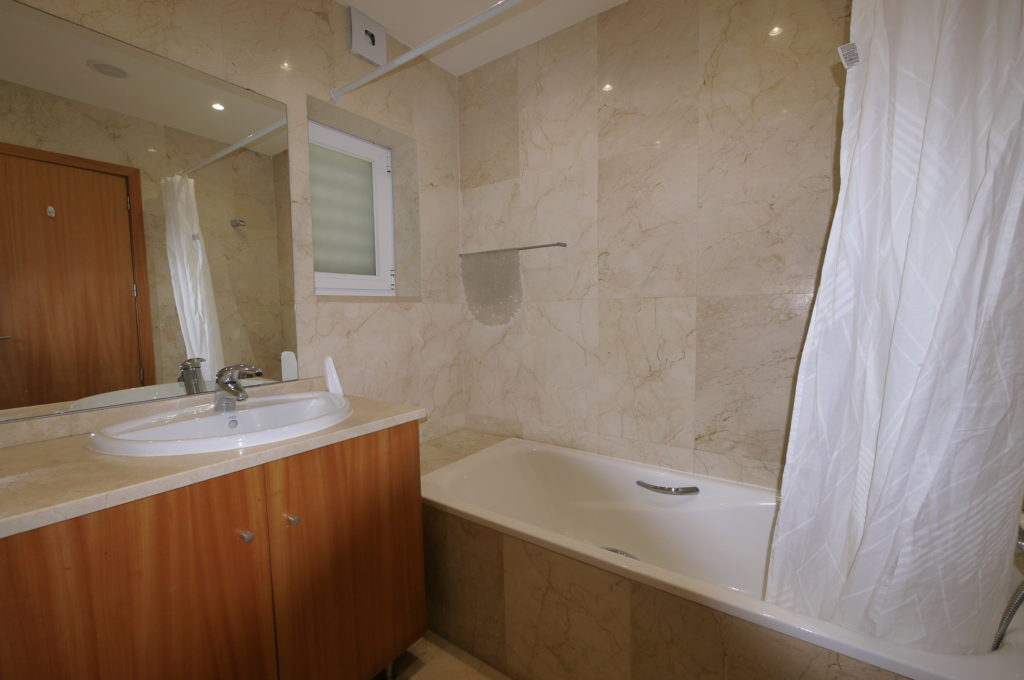 Ground floor Lime bedroom, marble flooring to ceiling private bathroom.