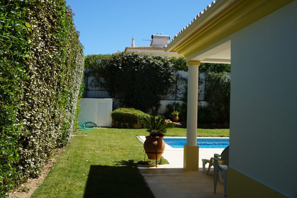 East side of the villa also has extensive lawn, High shrubs, flowers & black figs tree.