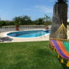 Villa Pateo pool area also with lawn areas.