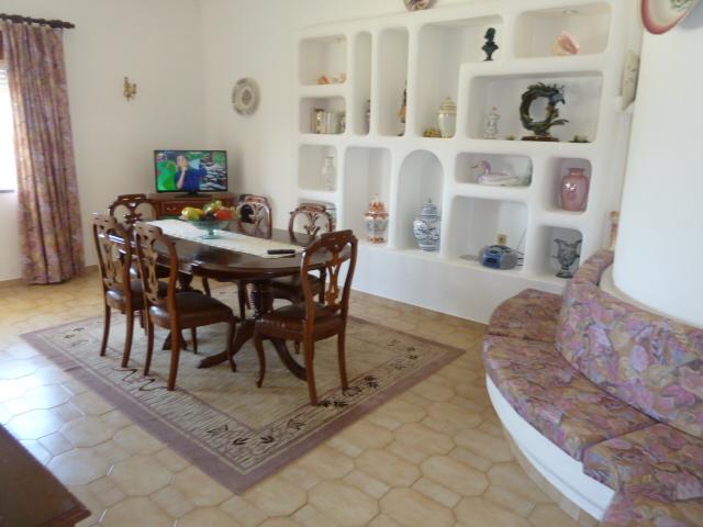 Ground floor, Dinning room with sofas & TV.