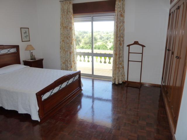 Double bedroom with east facing terrace overlooking pool.